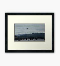 Hercules plane flying over Barmouth Framed Print
