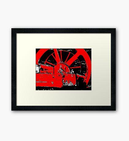 The Red Wheel Framed Print