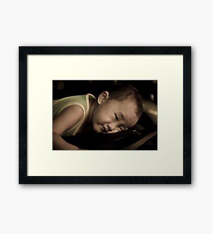 The Tired Child Framed Print