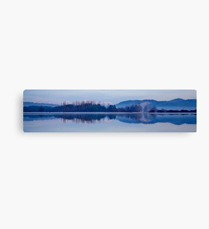 Cerknica lake at dawn with snow covered alps Canvas Print
