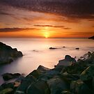 Sunset On The Rocks by Brian Kerr