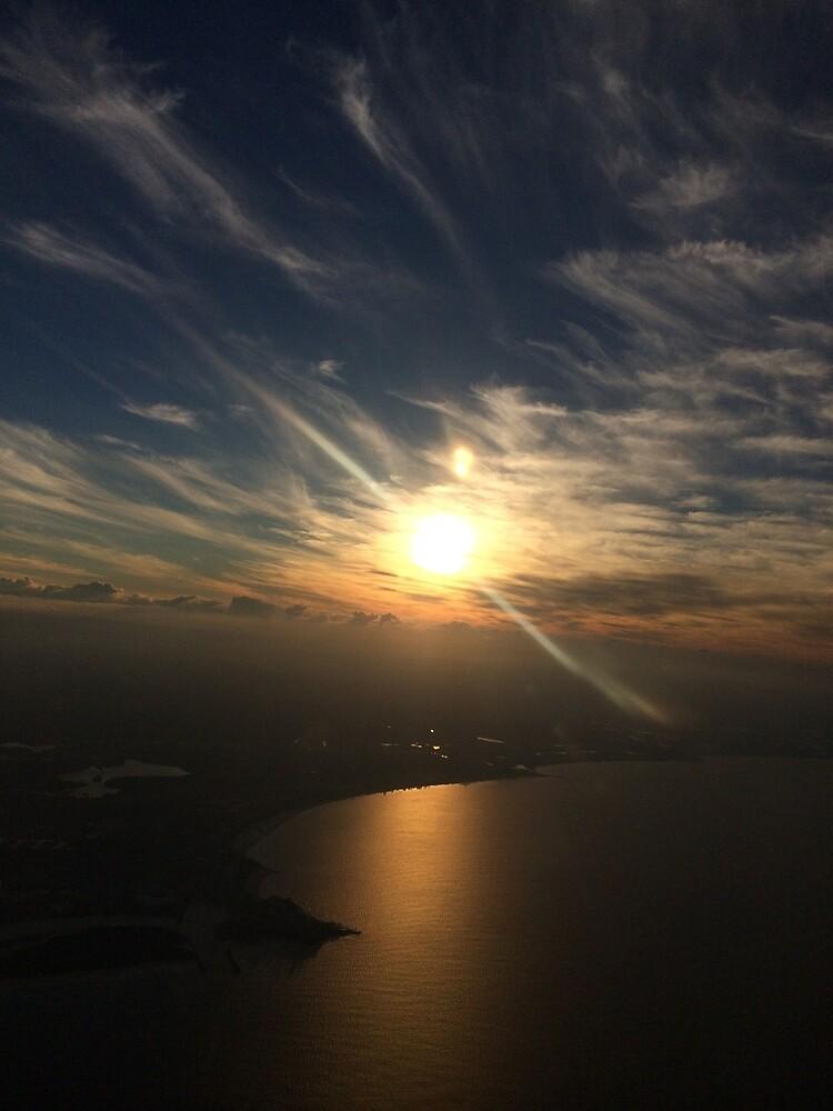 sun setting over the calm beach by FatLikeSnorlax