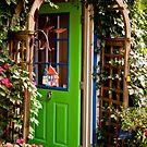 Behind the Green Door by Wanda Staples