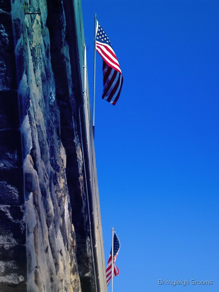american flag flying by Britnyleigh Grooms