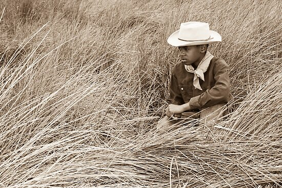 Young Cowboy in the Dunes by Denice Breaux