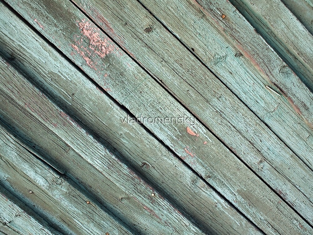 Diagonal view of the old fence from wooden planks by vladromensky
