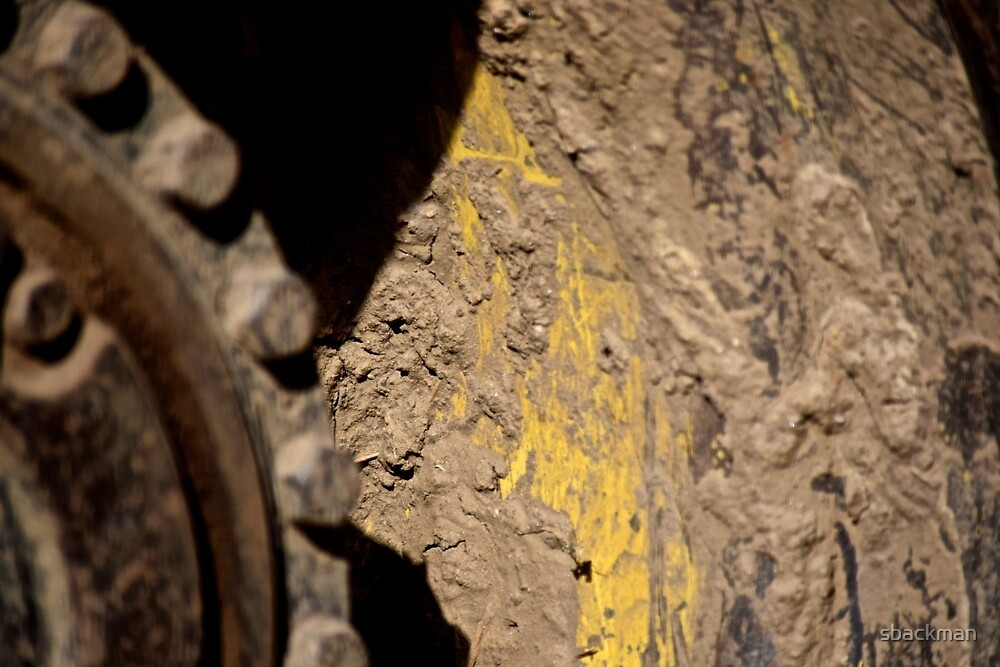 Mud caked tire by Spencer Backman