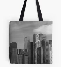 man's achievements reach higher and higher, often leaving him behind... Tote Bag