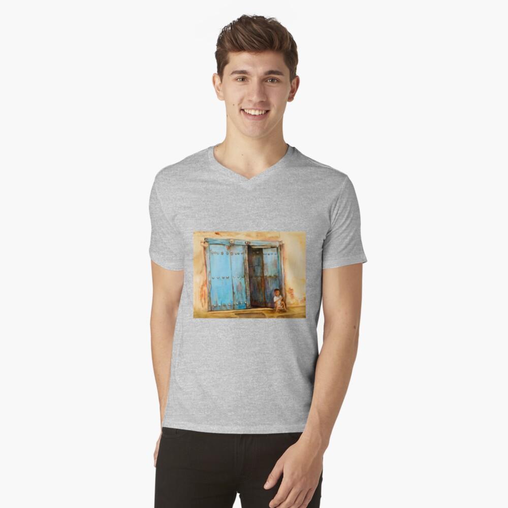 Child sitting in old Zanzibar doorway V-Neck T-Shirt