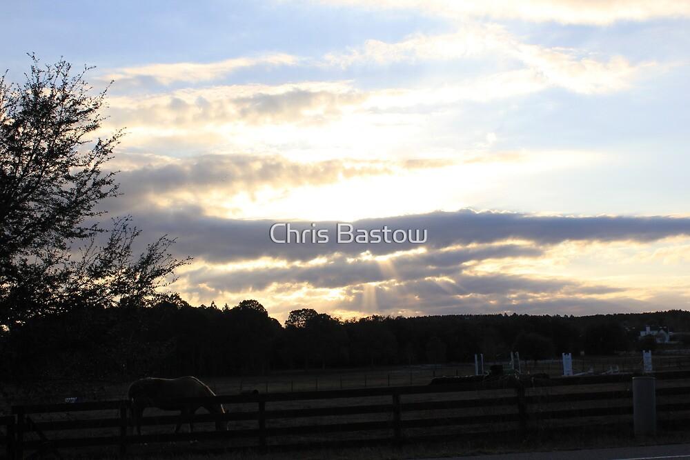 sun trough clouds by Chris Bastow