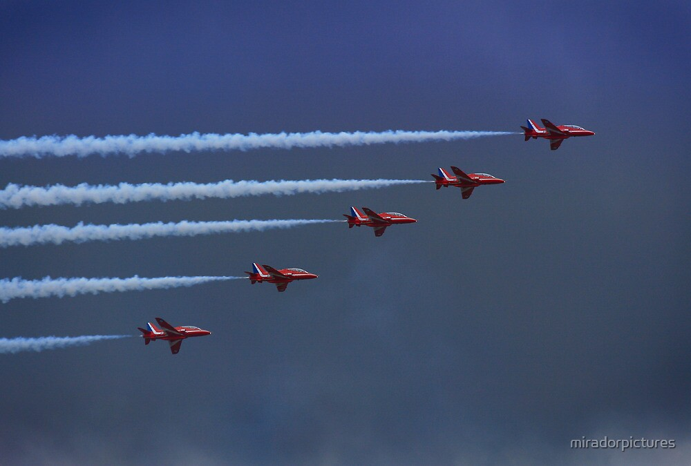 The Red Arrows British Air Display Team Fly In An Arrow Head Formation by miradorpictures