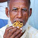 Mr Muslim Enjoys A Jalebi by AlliD