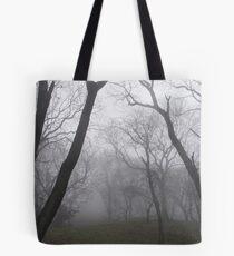 Eerie trees in mist Tote Bag