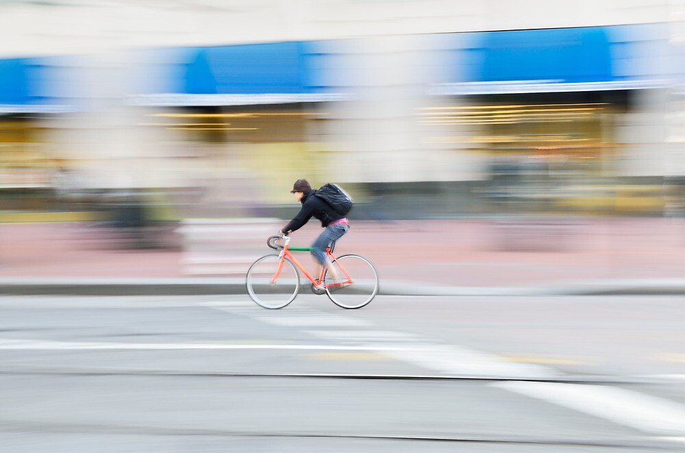 Cyclist riding at speed by Roi  Brooks