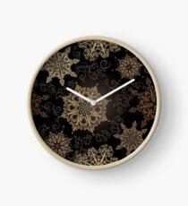 Golden Snowflakes on Black Clock