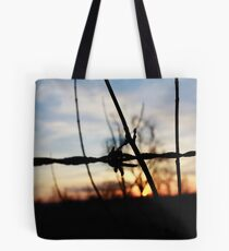 barbed fire sunset Tote Bag