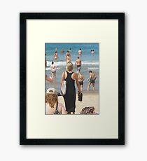 Black Dress amongst Sun Lovers  Framed Print