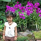 My Daughter At Botanical Garden, Singapore by Suresh Babu Subramanian