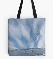 Jet stream clouds on an icy day Tote Bag