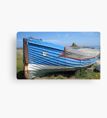 Beached boat on Holy Island Canvas Print