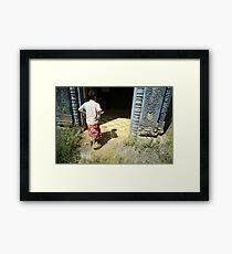at the doorway, oudong, cambodia Framed Print