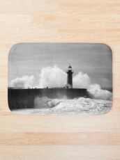 Lighthouse in stormy ocean Bath Mat