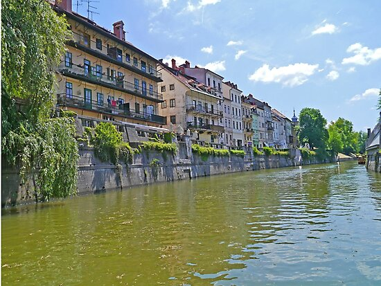 Homes along the Ljubanica River, Ljubljana, Slovenia by Margaret  Hyde