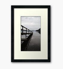Still waters under jetty Framed Print
