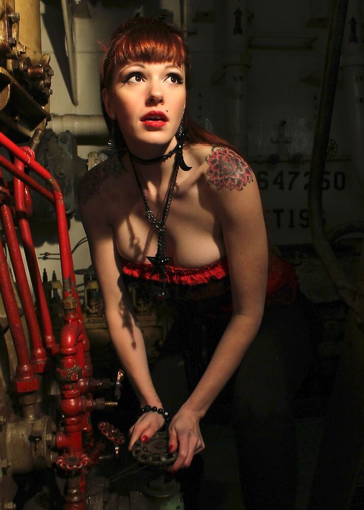 Kitty Works Below on The Tug Boat by Chad Almquist