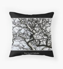 Crow in snow covered trees Throw Pillow