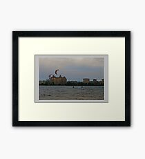 The hunter behind clouds Framed Print