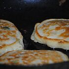Corn Fritters Frying In The Pan by Jonice