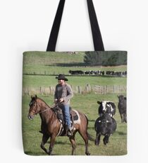 horseman being chased by cattle! Tote Bag