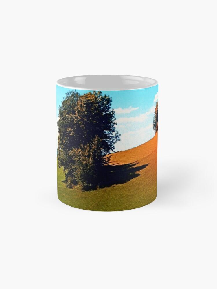 Alternate view of Trees, a hidden farm and fields of summer Mugs