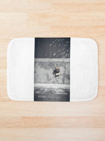Loneliness of a fisherman Bath Mat
