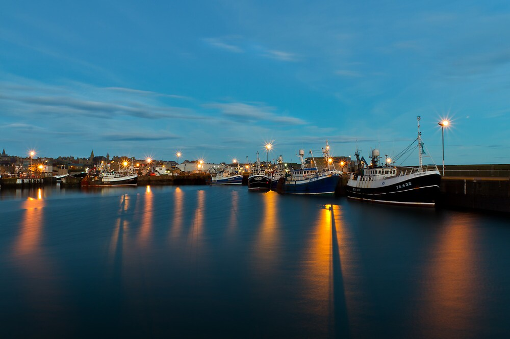 Harbour Lights At Dawn Reflecting in the Harbour Waters by Bill Buchan