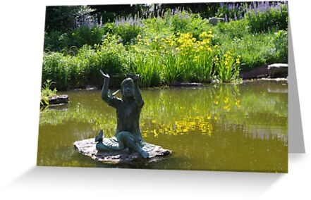 Statue of Little Girl with Butterflies in Pond by Paula Betz