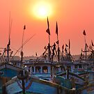 boats and the setting sun by Dinni H