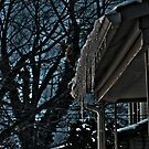 HDR of Ice hanging from a roof by Grant Taylor
