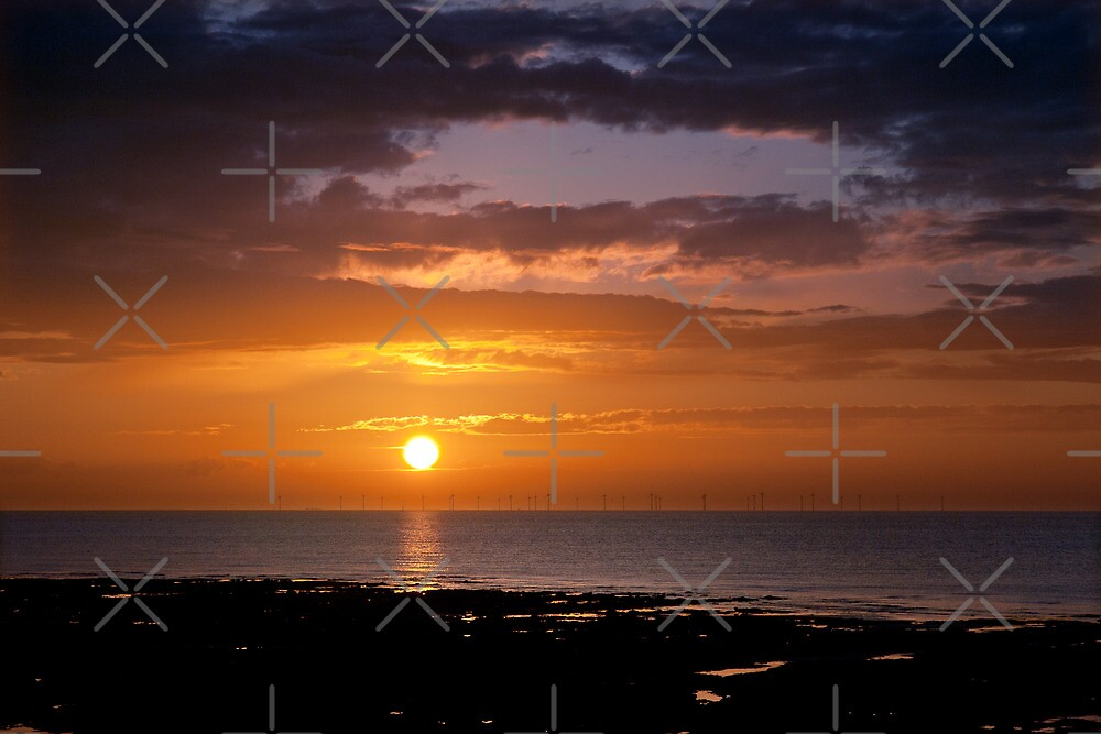 Sunset over the sea by Geoff Carpenter
