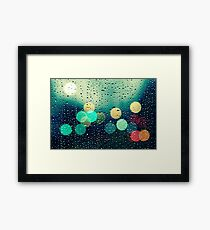 Rain and the city Framed Print